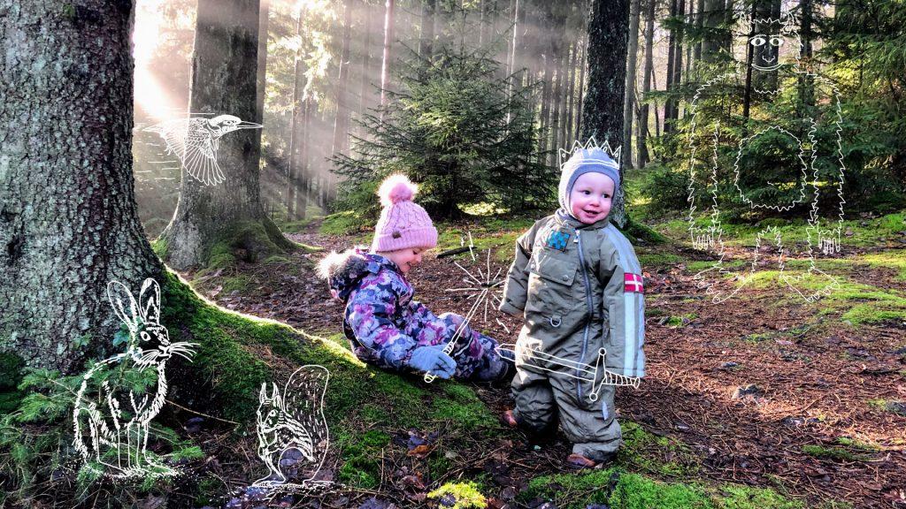 To børn i skoven med grafik på billede